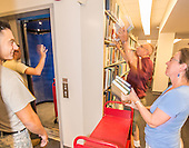 President Schneider and Students Move Library Books