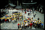 Yellow-capped schoolkids swarm lower court of Toshogu Shrine during field trip to Nikko. Japan