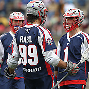 Paul Rabil #99 of the Boston Cannons and Will Manny #1 of the Boston Cannons celebrate a goal during the game at Harvard Stadium on April 27, 2014 in Boston, Massachusetts. (Photo by Elan Kawesch)