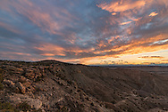 Colorful clouds fill the sky after sunset near Lovell, Wyoming.