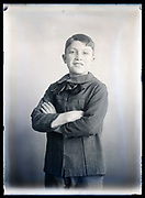 boy posing for a studio portrait circa 1920s