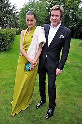 SIMON & YASMIN LE BON at the Raisa Gorbachev Foundation fourth annual fundraising gala dinner held at Stud House, Hampton Court, Surrey on 6th June 2009.