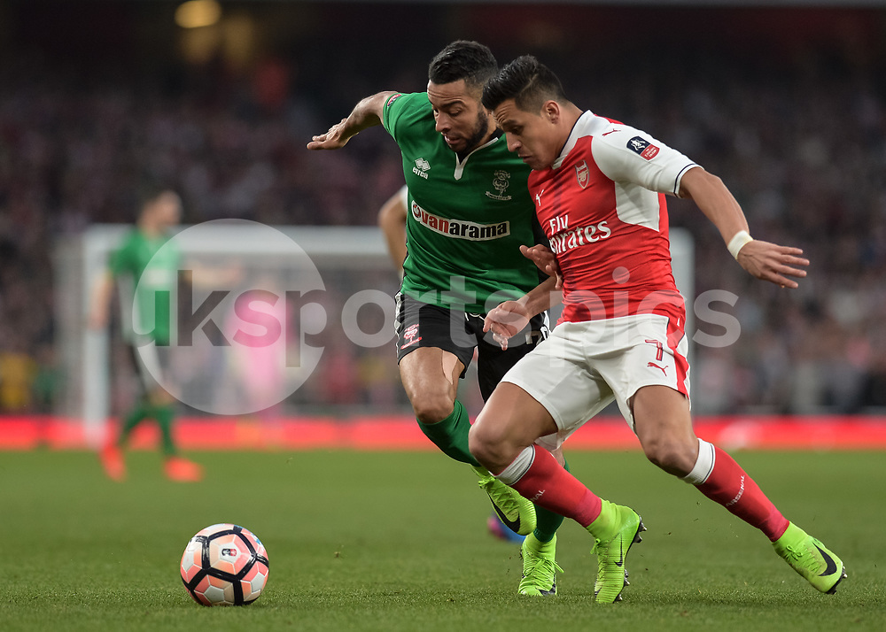 Alexis Sánchez of Arsenal battles with Nathan Arnold of Lincoln City during the The FA Cup sixth round match between Arsenal and Lincoln City at the Emirates Stadium, London, England on 11 March 2017. Photo by Vince Mignott.