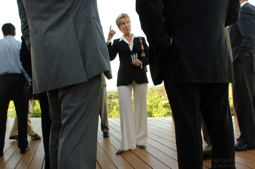 "Carly Fiorina, previously the CEO of Hewlett-Packard, talks with members and guests of Lead 21, a political organization for entrepreneurs, at a private residence in Los Altos Hills Tuesday evening, June 6, 2006. Fiorina is in the midst of publishing a new book titled, ""Tough Choices."".Event on 06/06/06 in Los Altos Hills...Photograph by Erin Lubin"