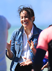 The Duchess of Sussex visiting Monwabisi Beach, to learn about the work of 'Waves for Change', an NGO which fuses surfing with evidence-based mind and body therapy to provide a child-friendly mental health service to vulnerable young people living in challenging communities. They also saw the work of The Lunchbox Fund, a charity that provides nearly 30,000 nutritious meals every day to Waves for Change programmes and schools in South Africa's townships and rural areas., Cape Town, South Africa. Photo credit should read: Doug Peters/EMPICS