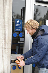 "© Licensed to London News Pictures. 19/02/2011. A demonstrator ""Feeding biscuits to hungry bankers""  during UK Uncut Protest at Barclays Bank New Cross Road London London today (19/02/2011). Demonstrations against low levels of tax paid by Barclays bank. by Photo credit should read: Tony Nandi/London News Pictures"