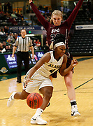 Kian McNair of Alaska Anchorage drives to the basket past Seattle Pacific's Erica Pagano during the second half of the Seawolves' 74-65 loss to the Falcons in a semifinal game at the Great Northwest Athletic Conference Tournament in Anchorage, Alaska on Friday, March 2, in Anchorage, Alaska. (Jay Christensen/Image of Sport)