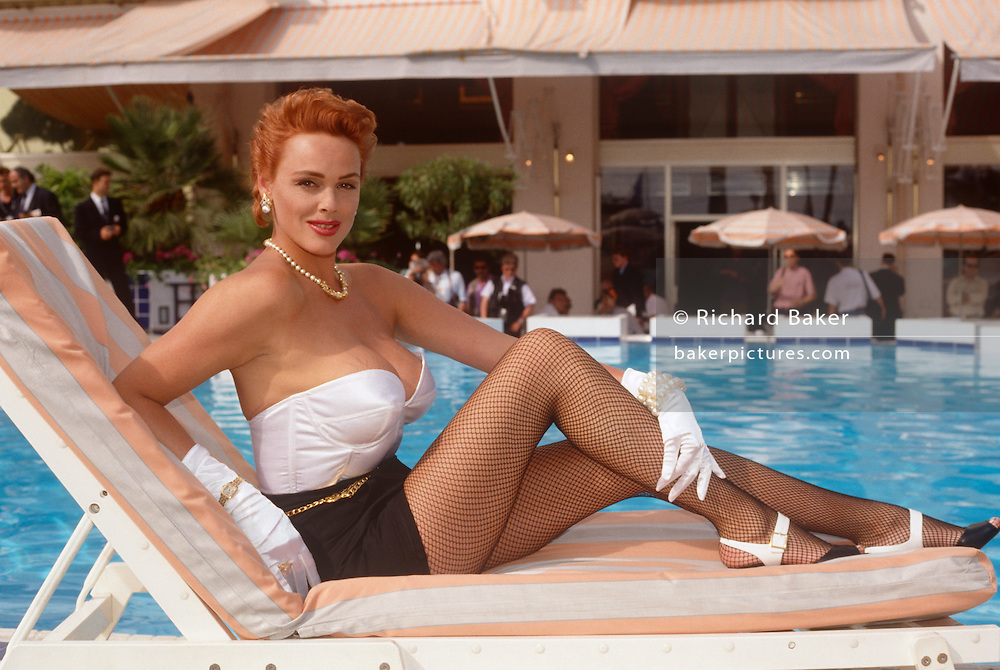 The Danish-born actor, Brigitte Nielsen seen poolside at the Cannes Film Festival on 10th May 1992, at Cannes, France. Brigitte Nielsen (born Gitte Nielsen; 15 July 1963) is a naturalised-Italian, Danish-born actress, model, singer and reality television personality who began her career modelling for Greg Gorman and Helmut Newton and several years later acted in the 1985 films Red Sonja and Rocky IV. She is also known for her marriage to Sylvester Stallone.
