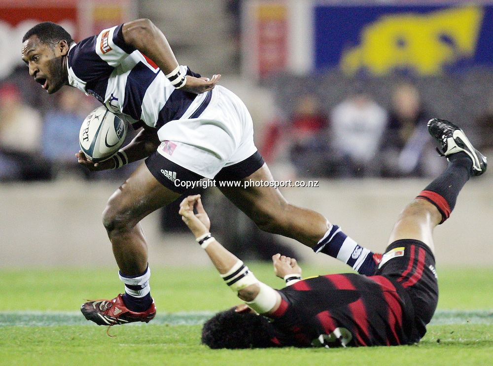 Joe Rokocoko runs over Casey Laulala during the Air NZ Cup rugby match between Auckland and Canterbury at Jade Stadium, Christchurch, New Zealand on Saturday 30 September, 2006. Canterbury won the match 27 - 22. Photo: Hannah Johnston/PHOTOSPORT<br /> <br /> <br /> <br /> <br /> 300906