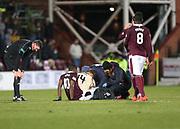 12th December 2017, Tynecastle Park, Edinburgh, Scotland; Scottish Premier League football,  Heart of Midlothian versus Dundee; Hearts' Arnaud Djoum and Dundee's Mark O'Hara receive treatment