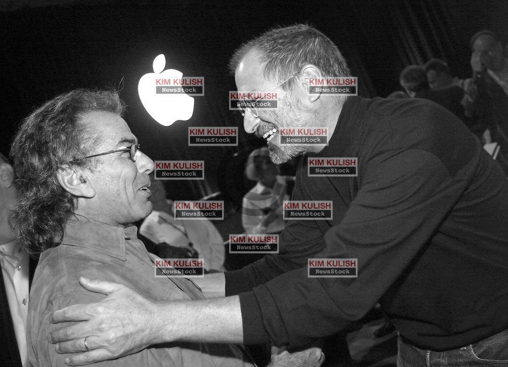 Steve Jobs, right, embraces Grateful Dead drummer, Mickey Hart following an Apple event where he announced that the Dead's music was now available on iTunes for the first time.