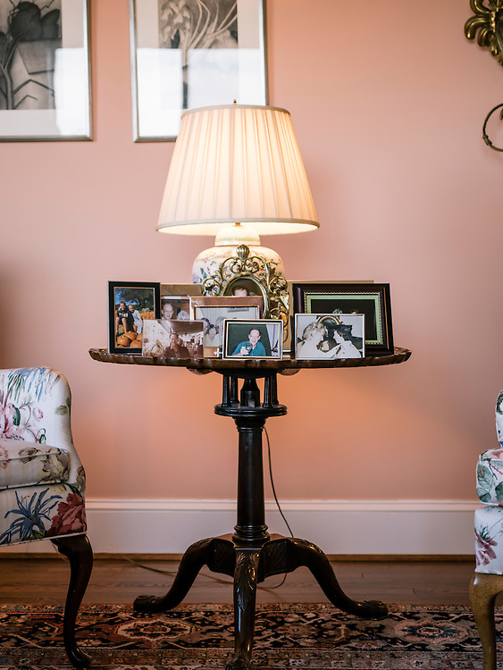 A table filled with family photos in the living room of Diane Rehm's home on the 14th floor of a condominium complex in the Glover Park area of Washington, D.C.