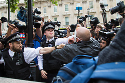 London, May 27th 2015. Police struggle to hold back a surging crowd outside Downing street as anti-austerity demonstrators attempt to make their way to Parliament Square.