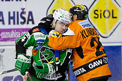 Roughing between Igor Cvetek (HDD Tilia Olimpija, #4) and Sven Klimbacher (Moser Medical Graz 99ers, #29) during ice-hockey match between HDD Tilia Olimpija and Moser Medical Graz 99ers in 42nd Round of EBEL league, on Januar 15, 2012 at Hala Tivoli, Ljubljana, Slovenia. HDD Tilia Olimpija defeated Moser Medical Graz 99ers 4:2. (Photo By Matic Klansek Velej / Sportida)