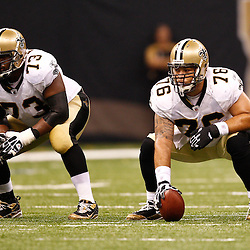 August 27, 2010; New Orleans, LA, USA; New Orleans Saints center Jonathan Goodwin (76) and guard Jahri Evans (73) line up for a play during the first half of a preseason game at the Louisiana Superdome. The New Orleans Saints defeated the San Diego Chargers 36-21. Mandatory Credit: Derick E. Hingle