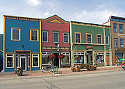 buildings painted in strong colors, western architecture, shops