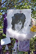 "Artistic Bradford ""Rest in Peace"" portrait of Prince hung on memorial fence. Paisley Park Studios Chanhassen Minnesota MN USA"