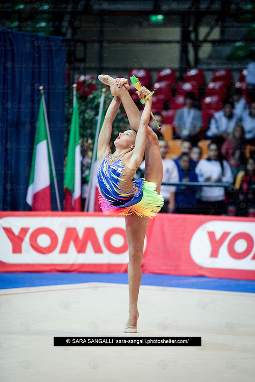 DESIO, ITALY - OCTOBER 31 2015: Alexandra Soldatova of Udinese performs with clubs at the italian national rhythmic gymnastic championship. Her score in the apparatus is 18,200. Her team's score is 94,300 and ended up in fourth position.