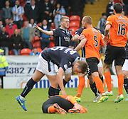 Dundee United's Jarosław Fojut faces up to Dundee's Jim McAlister after Dundee United's Nadir Çiftçi had been flattened  - Dundee United v Dundee at Tannadice Park in the SPFL Premiership<br /> <br />  - © David Young - www.davidyoungphoto.co.uk - email: davidyoungphoto@gmail.com