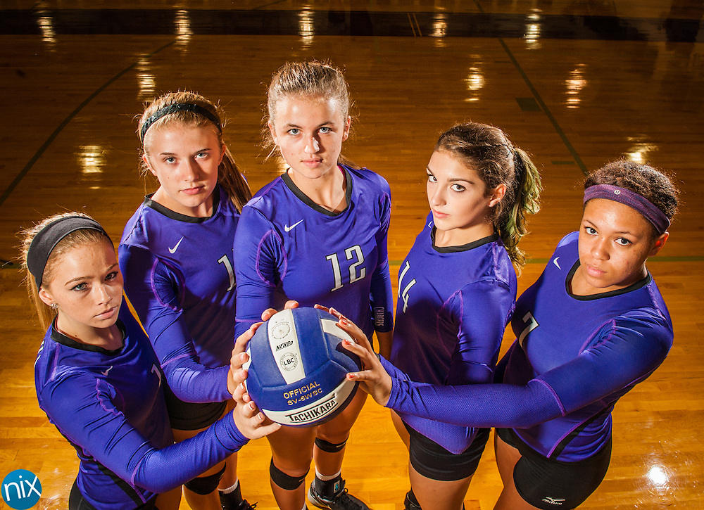 Cox Mill volleyball players, from left, Madison Lewis, Courtney Weber, Taylor Rowland, Lauren Phillips and Haley Henry.
