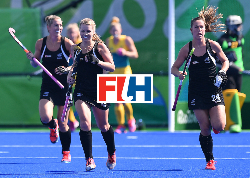 New Zealand's Kirsten Pearce (2nd L) and New Zealand's Rose Keddell (R) celebrate their opening goal during the the women's quarterfinal field hockey New Zealand vs Australia match of the Rio 2016 Olympics Games at the Olympic Hockey Centre in Rio de Janeiro on August 15, 2016. / AFP / Carl DE SOUZA        (Photo credit should read CARL DE SOUZA/AFP/Getty Images)