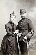 couple with male person in military uniform 1880s France