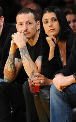 ©2011 GAMEPIKS 310-828-3445<br /> <br /> Linkin Park lead singer Chester Bennington and his wife Talinda Bentley sits courtside as he attends the Los Angeles Lakers/Portland Trail Blazers NBA game at Staples Center in Los Angeles on March 20, 2011. The Lakers defeated the Blazers 84-80.<br /> <br /> XYZ (Mega Agency TagID: MEGAR32159_5.jpg) [Photo via Mega Agency]