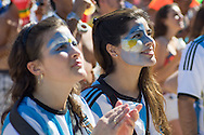 Two Argentina fans look on at the FIFA Fan Fest, Copacabana beach, Rio de Janeiro, during the Argentina v Belgium World Cup quarter final match which was shown on big screens.<br /> Picture by Andrew Tobin/Focus Images Ltd +44 7710 761829<br /> 05/07/2014