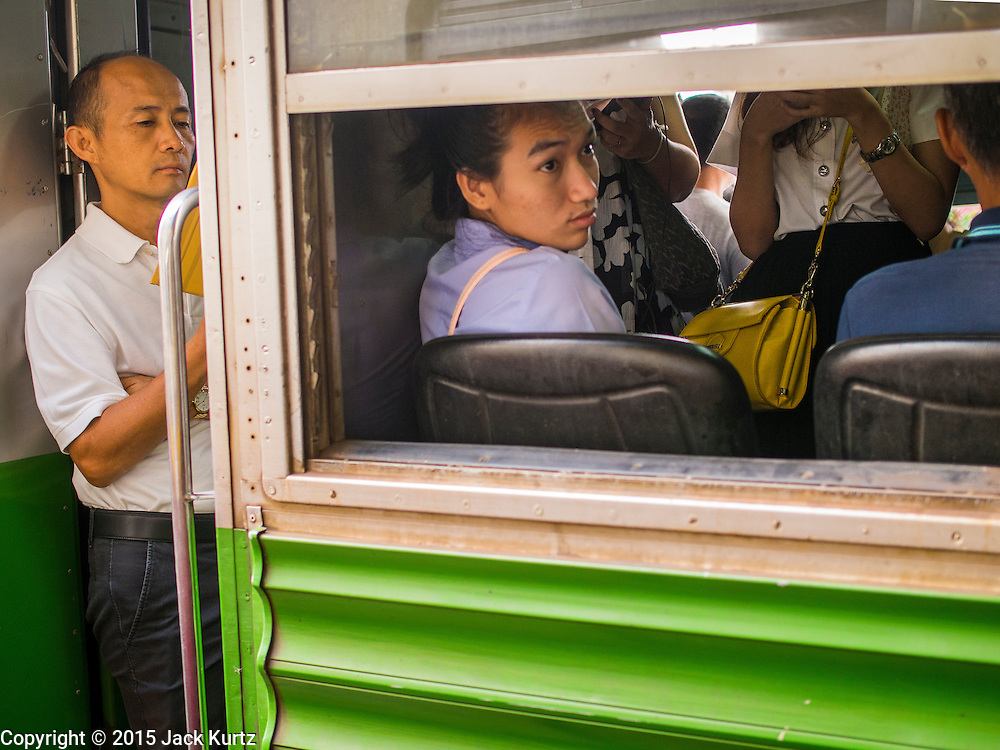20 MARCH 2015 - CHACHOENGSAO, CHACHOENGSAO, THAILAND:   Commuters coming into Bangkok on a third class train from Chachoengsao. The State Railways of Thailand (SRT), established in 1890, operates 4,043 kilometers of meter gauge track that reaches most parts of Thailand. Much of the track and many of the trains are poorly maintained and trains frequently run late. Accidents and mishaps are also commonplace. Successive governments, including the current military government, have promised to upgrade rail services. The military government has signed contracts with China to upgrade rail lines and bring high speed rail to Thailand. Japan has also expressed an interest in working on the Thai train system. Third class train travel is very inexpensive. Many lines are free for Thai citizens and even lines that aren't free are only a few Baht. Many third class tickets are under the equivalent of a dollar. Third class cars are not air-conditioned.    PHOTO BY JACK KURTZ
