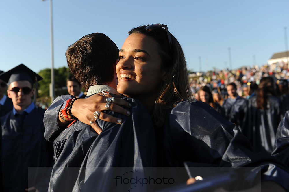 Samantha Sims embraces a classmate after graduating from Needham High School, Monday, June 6, 2016.<br /> Wicked Local staff photo / Kate Flock