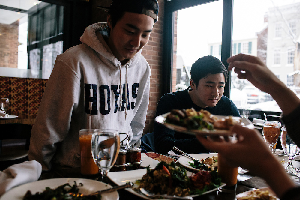 Roy Kim gets lunch with friends, including Brian Chung, right, at a Thai restaurant close to the Georgetown campus. Kim became a South Korean pop star after winning Superstar K4, his country's version of American Idol. Kim said that in South Korea, he would'nt be able to dine in public like he does in the US.