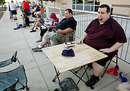 "Aaron Donoho (L) and Tony Carloni (R) wait in line at an open casting call for season 11 of ""The Biggest Loser"" television show in Broomfield, Colorado July 17, 2010.  Over 600 people applied for a chance to be on the show and win $250,000.  REUTERS/Rick Wilking (UNITED STATES)"