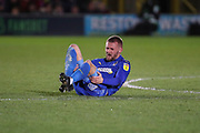 AFC Wimbledon attacker Shane McLoughlin (19) down injured and holding his leg during the EFL Sky Bet League 1 match between AFC Wimbledon and Ipswich Town at the Cherry Red Records Stadium, Kingston, England on 11 February 2020.