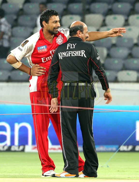 Praveen Kumar during warmup chats with umpire before match 15 of the Indian Premier League ( IPL ) between the Deccan Chargers and the Kings XI Punjab held at the Rajiv Gandhi International Cricket Stadium in Hyderabad on the 16th April 2011...Photo by Prashant Bhoot/BCCI/SPORTZPICS..