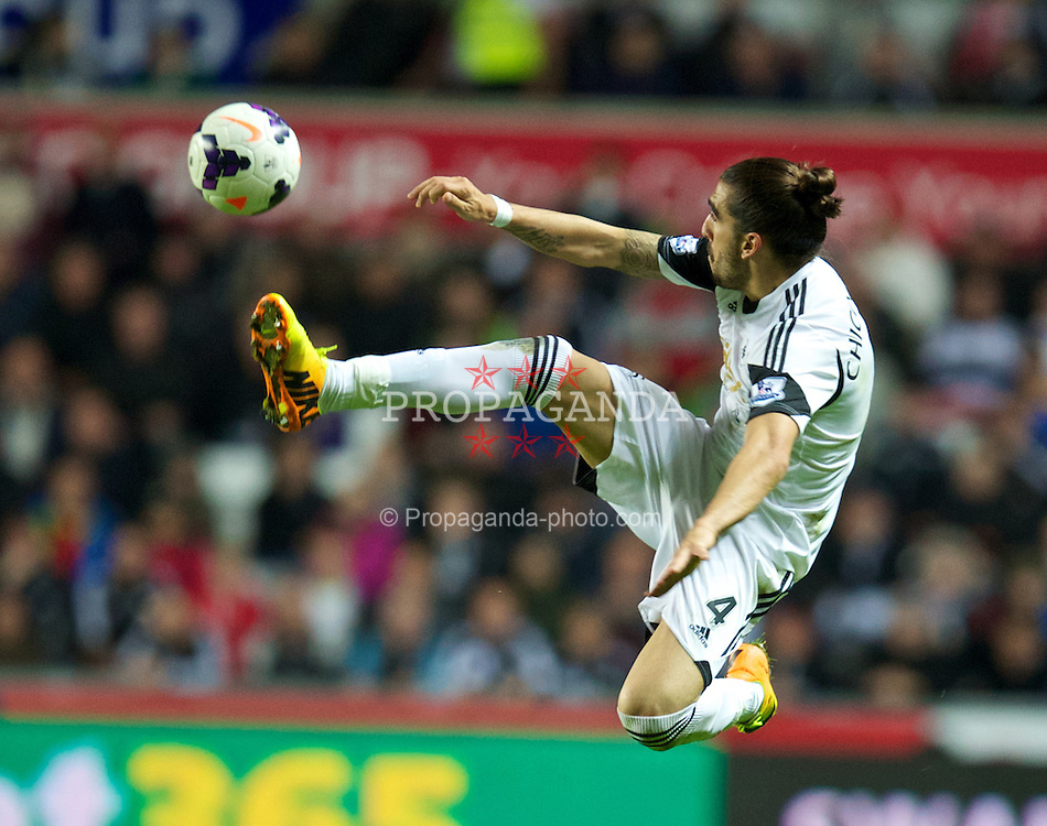SWANSEA, WALES - Monday, September 16, 2013: Swansea City's Chico Flores in action against Liverpool during the Premiership match at the Liberty Stadium. (Pic by David Rawcliffe/Propaganda)