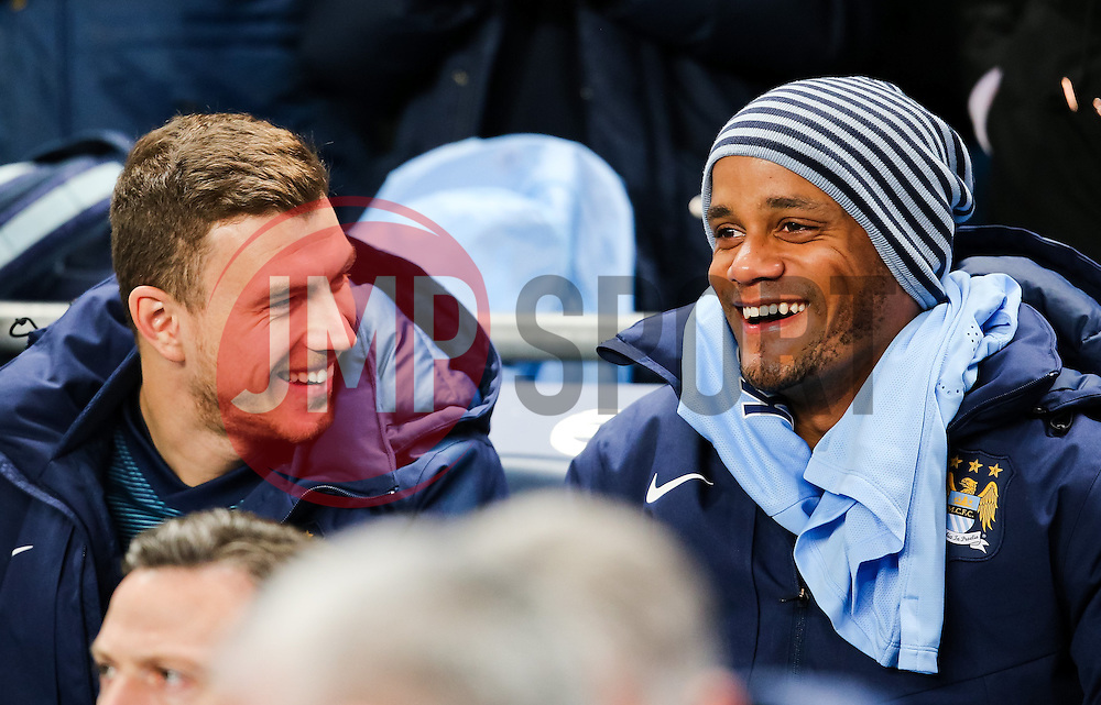 Manchester City's Vincent Kompany talks with Manchester City's Edin Dzeko before the game - Photo mandatory by-line: Matt McNulty/JMP - Mobile: 07966 386802 - 04/03/2015 - SPORT - football - Manchester - Etihad Stadium - Manchester City v Leicester City - Barclays Premier League