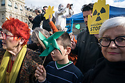 """France, Paris, 11 March 2018. Gathering anti-nuclear in Paris. On the occasion of 7th anniversary of Tofoku earthquake and tsunami which caused nuclear disaster in Fukushima, several associations and political party """"France Insoumise"""" organise a gathering to stop nuclear energy in France."""