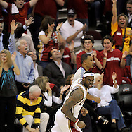 LeBron James runs upcourt after a slam dunk in the first half against Atlanta.