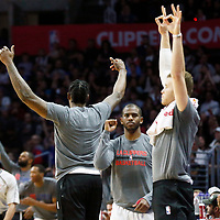 25 March 2016: LA Clippers guard Chris Paul (3), LA Clippers center DeAndre Jordan (6) and LA Clippers forward Blake Griffin (32) celebrate during the Los Angeles Clippers 108-95 victory over the Utah Jazz, at the Staples Center, Los Angeles, California, USA.