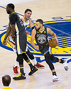 Golden State Warriors guard Stephen Curry (30) handles the ball against the New Orleans Pelicans at Oracle Arena during Game 2 of the Western Semifinals in Oakland, California, on May 1, 2018. (Stan Olszewski/Special to S.F. Examiner)