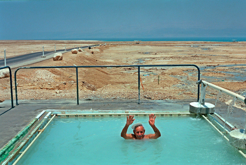 An Israeli elder excercises in a sulfur pool next to the shore of the Dead Sea in Israeli Saturday July 7, 2001. Despite the 11 months of violence Israelis and Palestinians take a break to enjoy the mediterrenean beaches and the Dead Sea, where under growing tensions and in the case of Gaza under closure people try to  make the best of their summer and carry on a normal life.