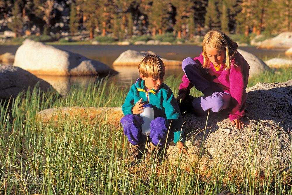 Kids (ages 5 & 9) exploring the shore of Muir Lake, John Muir Wilderness, Sierra Nevada Mountains, California