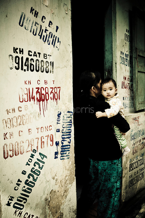 Mother holding child, French Quarter, Hanoi, Vietnam