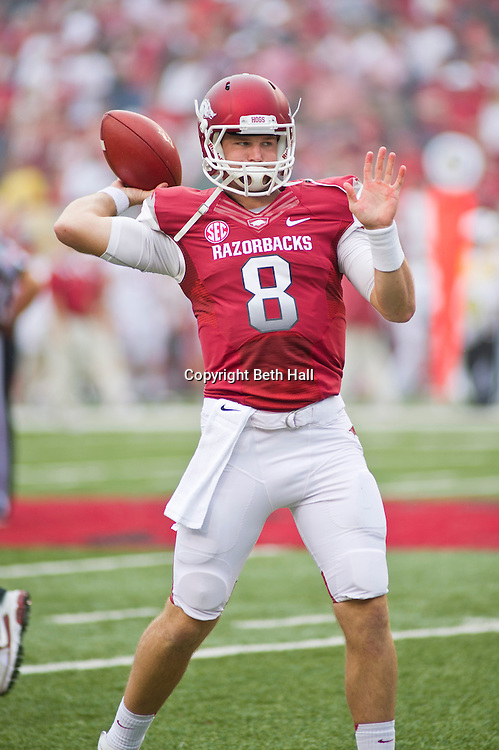 Sep 15, 2012; Fayetteville, AR, USA; Arkansas Razorback quarterback Tyler Wilson (8) warms up before the start of a game against the Alabama Crimson Tide at Donald W. Reynolds Razorback Stadium. Alabama defeated Arkansas 52-0. Mandatory Credit: Beth Hall-US PRESSWIRE