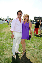 Actress TINA HOBLEY and her husband OLIVER WHEELER at the Cartier International Polo at Guards Polo Club, Windsor Great Park on 27th July 2008.<br /> <br /> NON EXCLUSIVE - WORLD RIGHTS