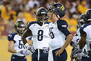 TEMPE, AZ - SEPTEMBER 03: Quarterback Case Cookus #15 of the Northern Arizona Lumberjacks stands on the field alongside wide receiver Emmanuel Butler #8 prior to the game Arizona State Sun Devilsa at Sun Devil Stadium on September 3, 2016 in Tempe, Arizona. The Sun Devils won 44-13.  (Photo by Jennifer Stewart/Getty Images)
