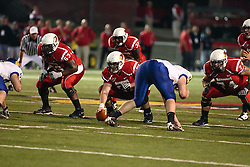 26 September 2009: Center Cal McCarthy is flanked by Charles Dennis (63) and Nick Bledsoe and Gordon Clifton offsets right while waiting for the signals from Matt Brown in a game which the South Dakota State Jackrabitts jump past the Illinois State Redbirds 38 - 17 at Hancock Stadium on campus of Illinois State University in Normal Illinois