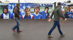 Fans walk past a timeline mural outside St Andrews, home of Birmingham City