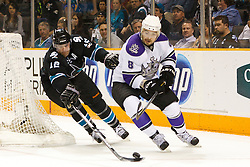 April 4, 2011; San Jose, CA, USA;  San Jose Sharks center Patrick Marleau (12) reaches for a loose puck in front of Los Angeles Kings defenseman Drew Doughty (8) during the first period at HP Pavilion. Mandatory Credit: Jason O. Watson / US PRESSWIRE