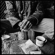 Alpsommer. Regenwetter. Viel Zeit zum Nachdenken und Rauchen. <br /> Rainy day, lonely summer. Young shepherd smoking inside his hut. <br /> Quand il pleut à l'alpage le garde-génisse se réfugie à l'intérieur. Les heures passent lentement, en fumant et en buvant. © romano p. riedo | fotopunkt.ch<br /> A shepherd or sheepherder, is a person who tends, herds, feeds, or guards flocks of sheep.